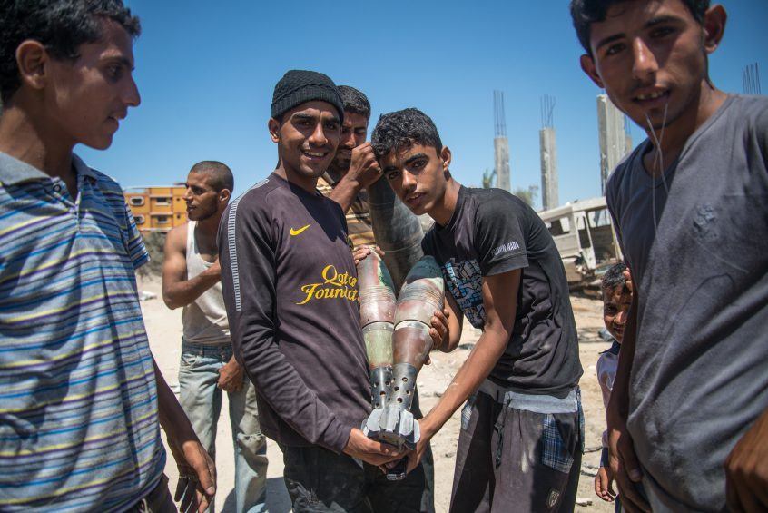 Kids in Gaza showing off their found israeli rockets during the war in 2014.