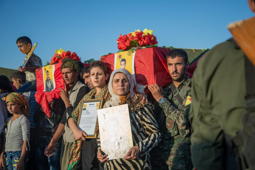 Families carrying their fallen sons and daughters during the war against ISIS, Rojava, 2014.