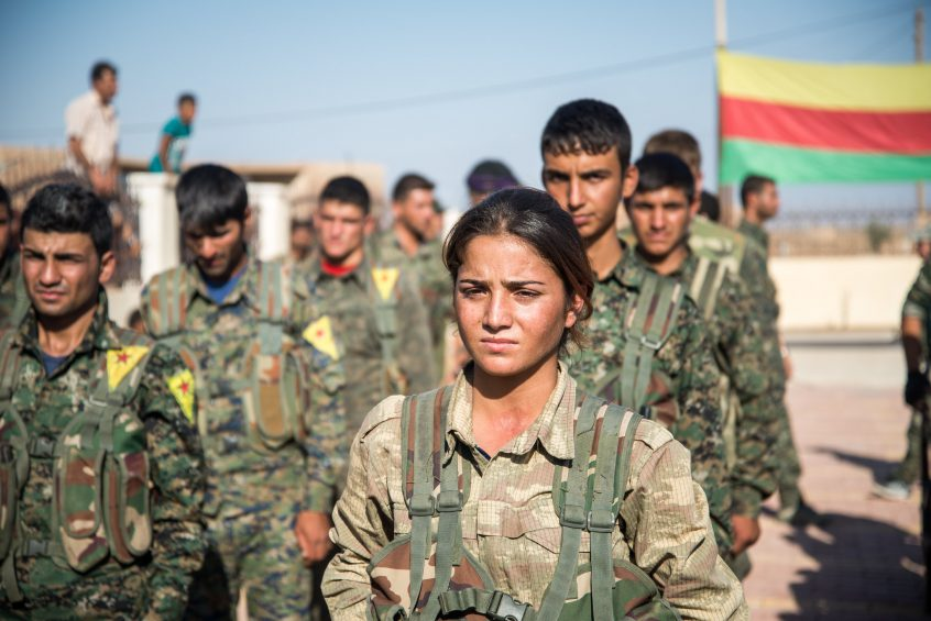 Kurdish fighters attendig a funeral near Hasake, Rojava, Syria.